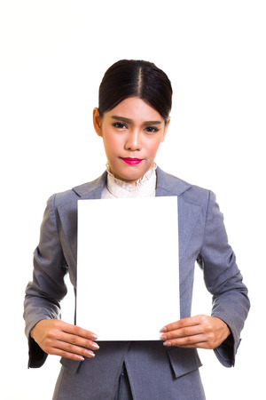 hoja en blanco: Business woman standing behind a blank board on white background