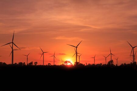 power generator: Wind turbine power generator at twilight sunset Stock Photo
