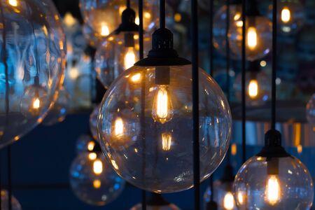 holiday lighting: Gold lighting decoration, holiday background Stock Photo
