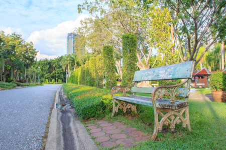 spring time: Bench in beautiful city park in spring time Stock Photo