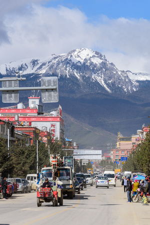 shangrila: SHANGRI-LA, CHINA - April 20, 2016:Traffic intersection in the Shangri-la city with the snow mountains background. Editorial