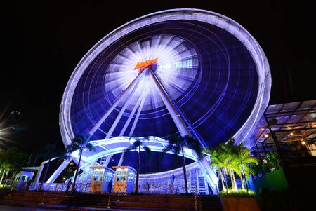 riverfront: Bangkok,Thailand - June 21 2014:Lights of the Ferris wheel at night at ASIATIQUE The Riverfront.