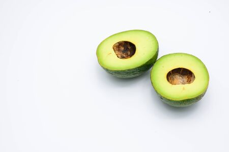 two and a half: Two half avocado isolated on a white background.