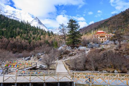 mountain snow: Tibetan temple is located in the rainforest mountain snow. Stock Photo