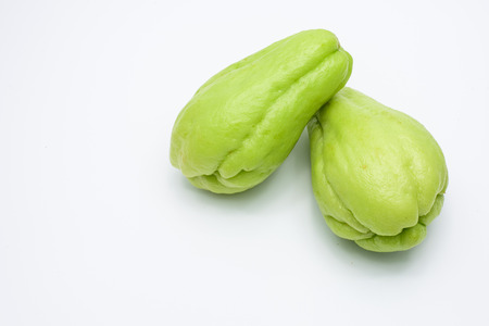Two fresh Chayote fruits isolated on white background.