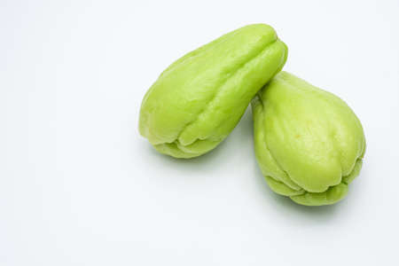 Sliced fresh Chayote and half isolated on white background. Stock Photo