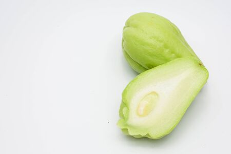 chayote: Sliced fresh Chayote and half isolated on white background. Stock Photo