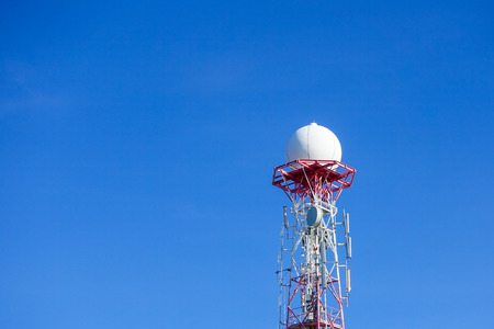 faa: Radar dome in the sea with blue sky and clouds background. Stock Photo
