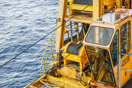 maneuverable: Cabin crane boom structure and metal sling on blue sky and sea background