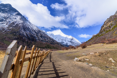 jokul: Wooden fence or wooden wall for yak farm in the Snowy Mountains at Yading Nature Reserve, China.