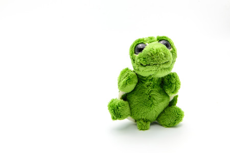 Green turtle doll with happy emotion isolated on white background Stock Photo