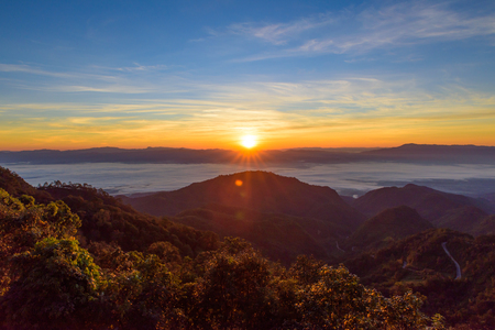 sun rise: View of sun rise morning mist  at Doi Ang Khang mountain one of the famous mountains in Chiangmai,Thailand Stock Photo