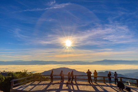 sun rise: People watching sun rise morning mist  at Doi Ang Khang mountain one of the famous mountains in Chiangmai,Thailand Stock Photo
