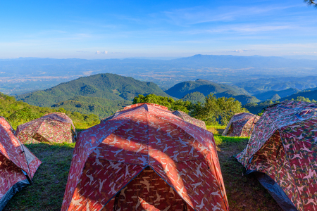 sun rise: View of morning mist and sun rise at Doi Ang Khang mountain one of the famous mountains in Chiangmai,place for camping with tent on winter, Chiang Mai, Thailand.