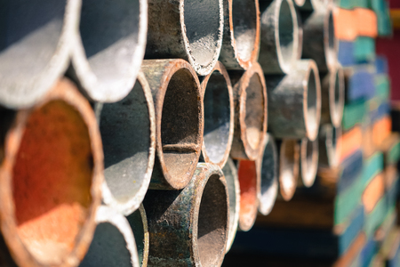 shelve: Multi color scaffolding pipe row on shelve in industrial plant or oil and gas platform. Stock Photo