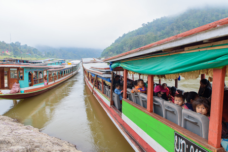 PAKBANG, LAOS - February 16, 2017: Slow boat from Chiangkhong to Luang Prabang while alongside at Pakbang, Laos for allow tourists to stay overnight.