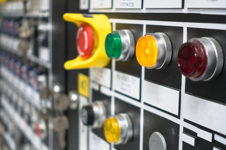 Selective focus Control panel with lots of buttons and light bulb for control and monitor process in plant or oil and gas platform.
