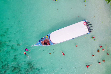 Aerial view over speed boat with beautiful sea and beach,Top view from drone, Koh Lipe island, Satun,Thailand.