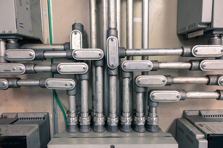 Electrical Conduit connected to junction box for connect electrical cable in box, with vintage tone for industrial technology concept 스톡 콘텐츠