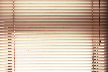 roller: window blinds open with blur natural view background in vintage tone.
