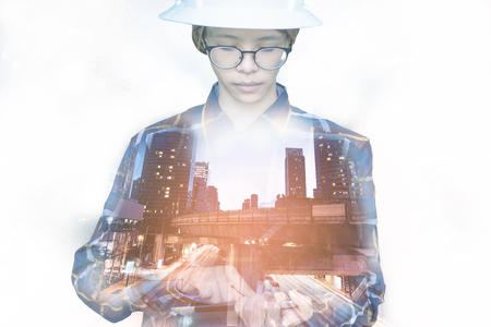 revolutionary: Double exposure of  Engineer or Architecture woman in hipster shirt and safety helmet working with tablet in night building background , business and construction concept.