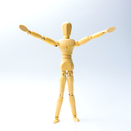 Wooden figure doll with Stretch arms to hug for peace concept. Stock Photo