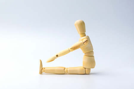 Wooden figure doll with Stretch arms and leg on white  for exercise training and helth concept.