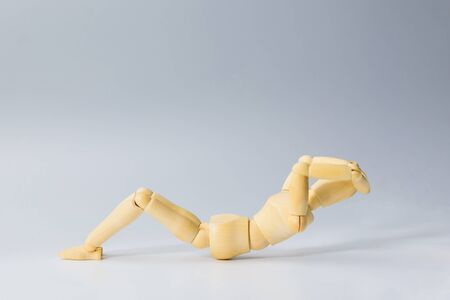 Wooden figure doll with sit up for health on white  for exercise training and helth concept.