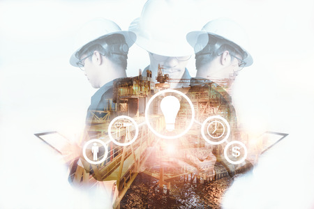 Double exposure of Engineer or Technician man with industry tool icons for management business by using tablet with safty helmet & uniform for oil and gas industrial business concept.
