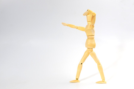marioneta de madera: Wooden figure doll with looking emotion for success business concept on white background.