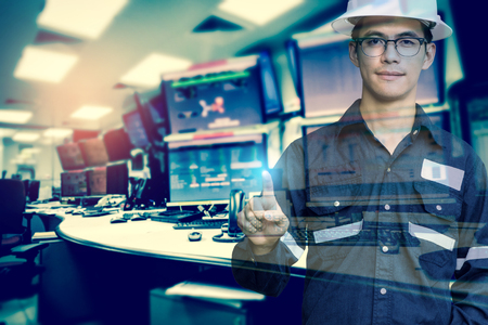 dispatcher: Double exposure of  Engineer or Technician man in working shirt press his finger for new innovation with group of computers room background, business and industry concept. Stock Photo