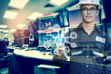 Double exposure of Engineer or Technician man with business industrial tool icons while pointing finger with monitor of computers room for oil and gas industrial business concept.