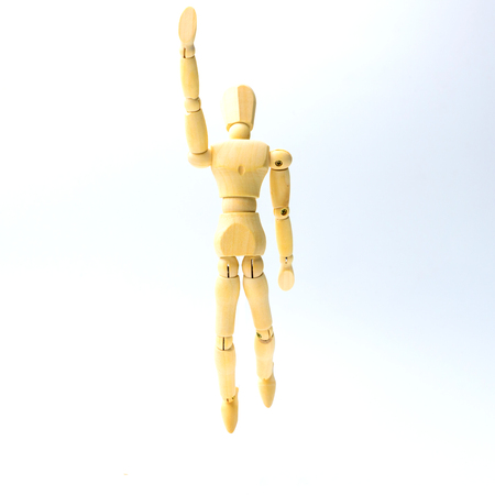 marioneta de madera: Wooden figure doll with jumping emotion for success business concept on white background.