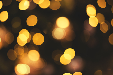 Gold abstract defocus bokeh background for newyear celebrate.