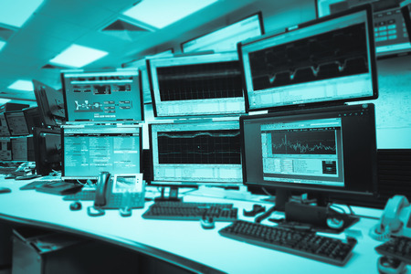 System Control Room IT with many monitor  in a High-Tech Facility That Works on the Surveillance, Neural Networks, Data Mining. Stockfoto