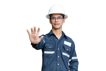 Engineer or Technician in white helmet, glasses and blue working shirt suit while push hand to stop working, isolated on white, for safety first concept with clipping path.