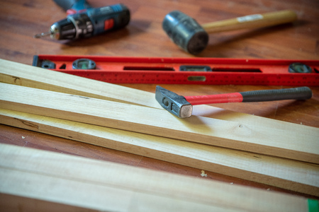 Different construction tools with Hand tools for home renovation on wooden board maintenance and reparing concept.