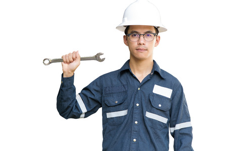 Asian man,Engineer or Technician in white helmet, glasses and blue working shirt suit holding wrench, isolated on white, mechanic and Oil and Gas industrial concept with clipping path. Stok Fotoğraf