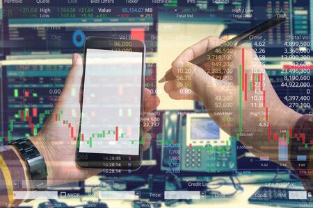 Double exposure of hand of business man using smartphone with stock trading room and stock trading chart background for investment business concept.