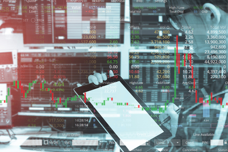 Double exposure of business woman using tablet with stock trading room and stock trading chart background for investment business concept. 스톡 콘텐츠