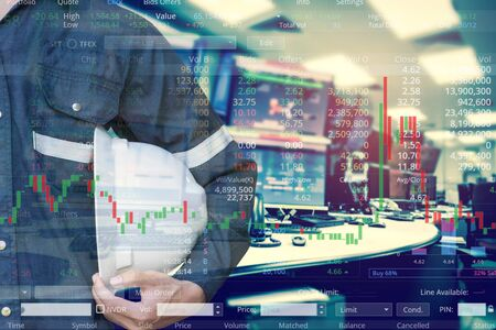 Double exposure of  business man or Engineer holding helmet with stock trading room and stock trading chart background for investment business concept.