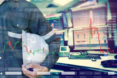 Double exposure of  business man or Engineer holding helmet with stock trading room and stock trading chart background for investment business concept. 스톡 콘텐츠 - 132134552