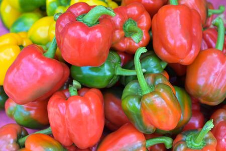 Colorful green , red green and yellow peppers paprika background in the street  market.