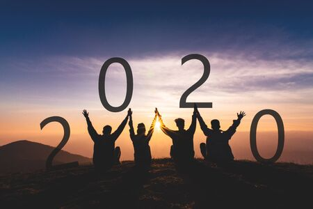 Newyear 2020 concept Silhouette of young friend jumping and hand shake for celebrate new year party.