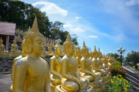 The Group of golden Buddha statues of Phu Salao temple in the Pakse city, Champasak Province, Southern Laos.