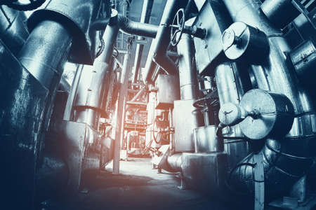 Industry plant concept,Equipment, cables and piping as found inside of a modern industrial power plant or offshore platform.