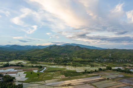 Aerial view of terraced rice field and mountains in harvest season at Chiang mai, Thailand.