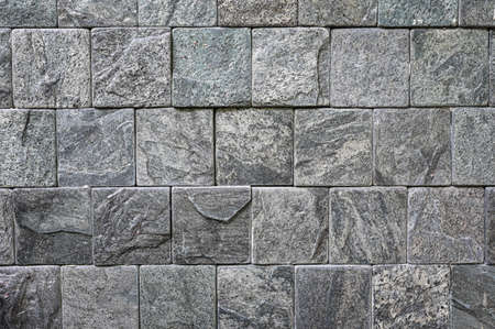 Background wall made of gray stone texture. 版權商用圖片