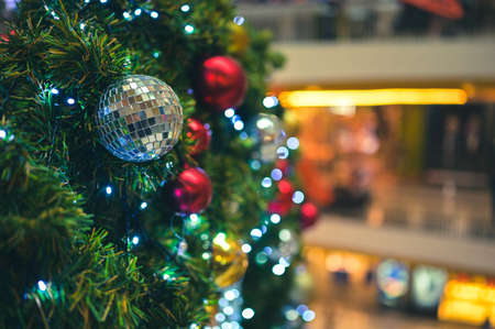 Decorated Christmas tree and New Year holidays  sparking, glowing. Happy New Year theme Blurred bokeh background.