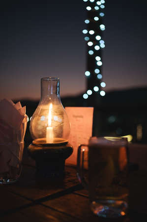 Luxury romantic candlelight dinner table setup for couple in restaurant on Valentine's day with Champaign & wine glasses and beautiful food decoration.